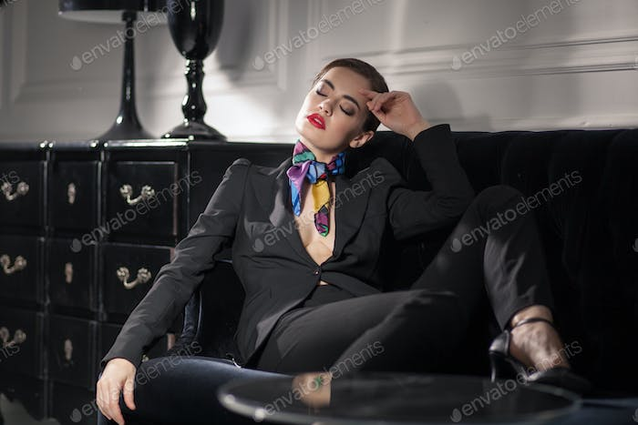 tired business woman resting on the couch
