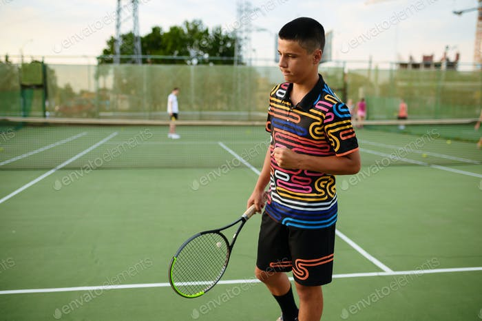 Centred male tennis player with rackets