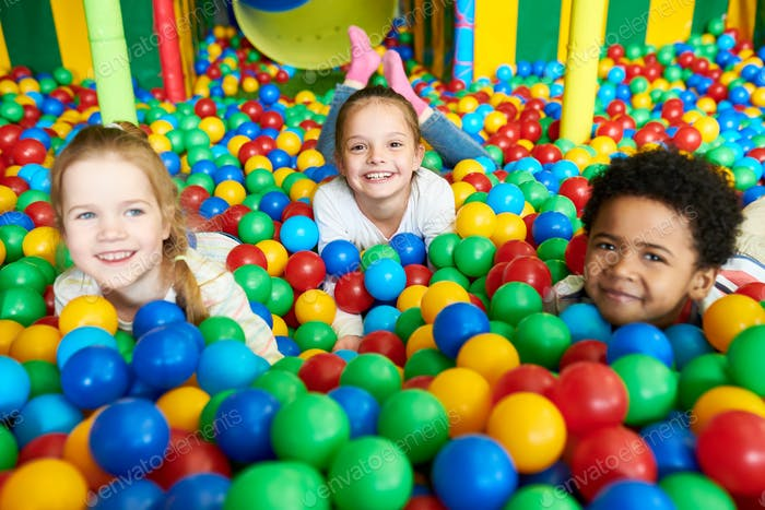 Cute Little Kids Playing in Ballpit