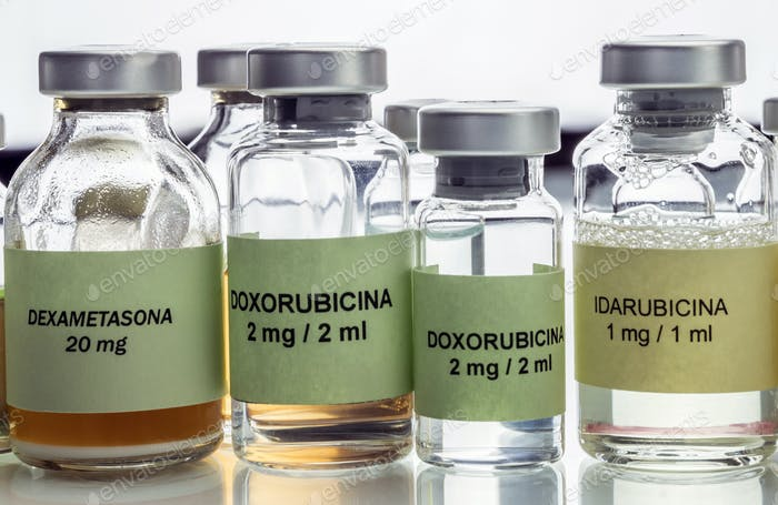 Vials of different size with medication used for neurodegenerative diseases, conceptual image
