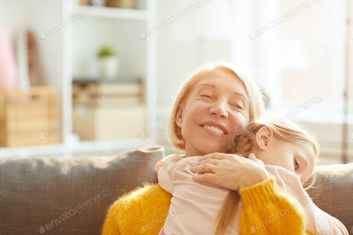 Caring Mother Embracing Child
