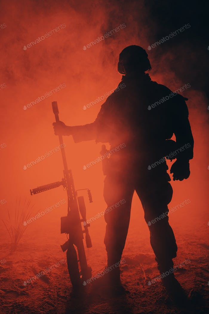 Army sniper in the fire and smoke