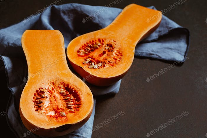 View on raw halves of butternut squash on a kitchen table