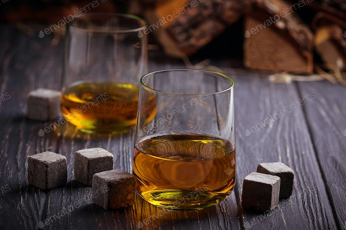 Glass of whiskey with stones