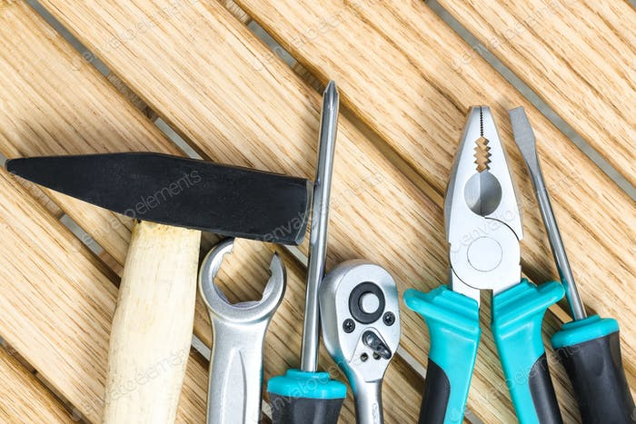 set of tools on a wooden background