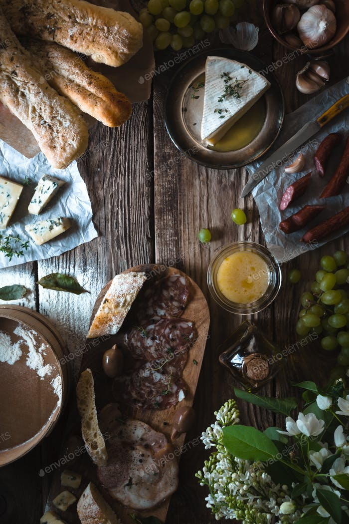Assortment of appetizers on the wooden background vertical
