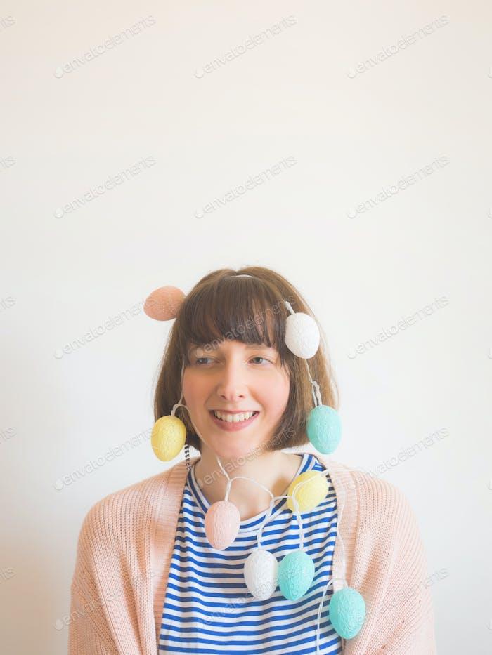 Easter concept female portrait with egg lights