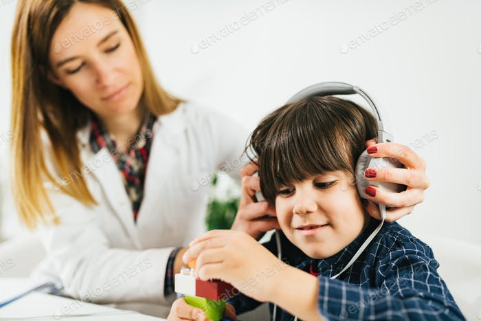 Pediatric Audiologist Testing Hearing with a Little Boy