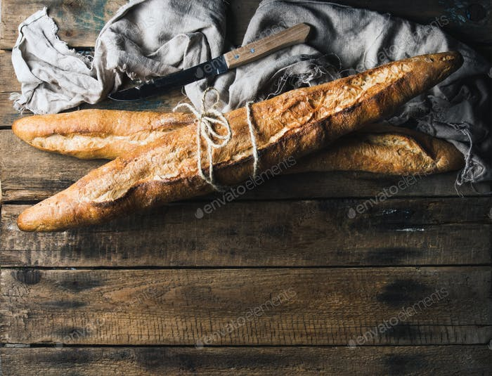 French baguettes on rough rustic wooden background