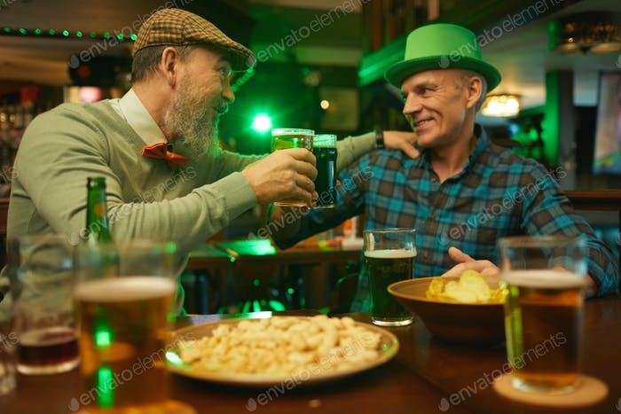 Mature friends drinking beer in the bar