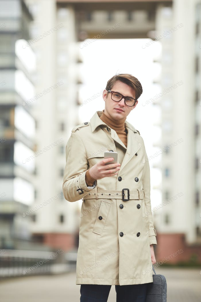 Young Man Wearing Trenchcoat in City