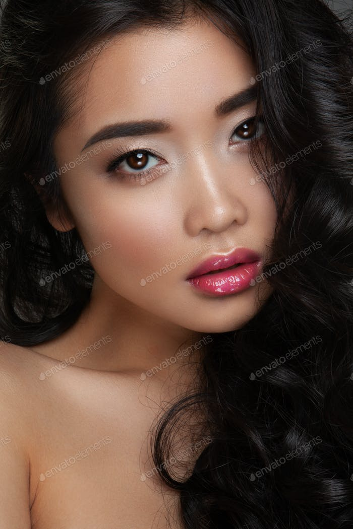 closeup young woman face with clean skin, pink lips