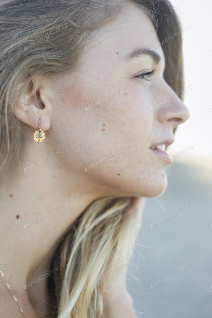 Profile portrait of a blond woman.