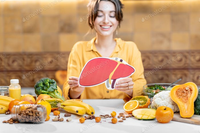 Human liver model and variety of healthy fresh food