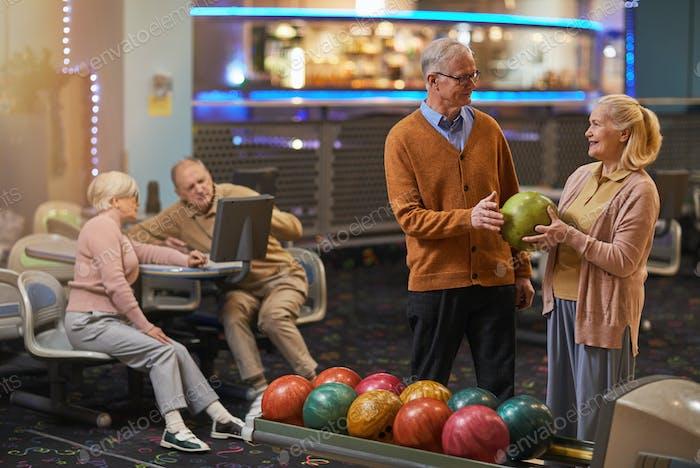 Joyful Senior Couple Playing Bowling