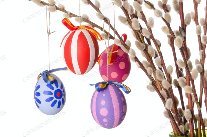 Easter eggs on willow bouquet with catkins, horizontal