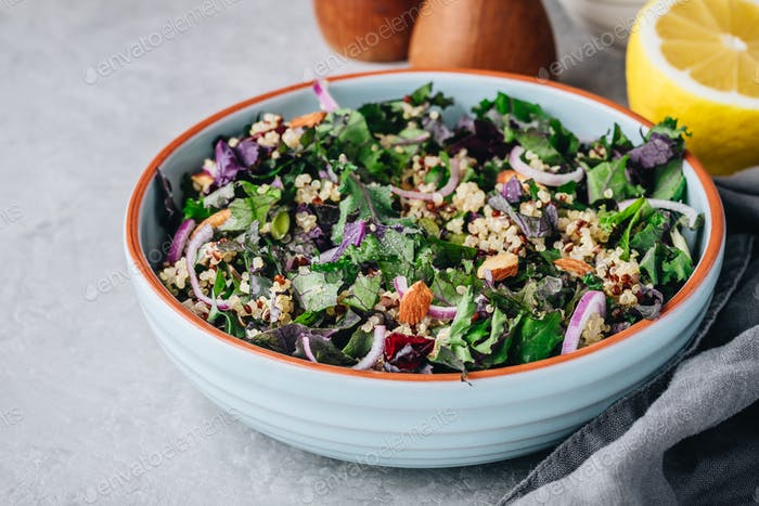 Healthy bowl kale and quinoa salad with cranberry, red onions and almonds