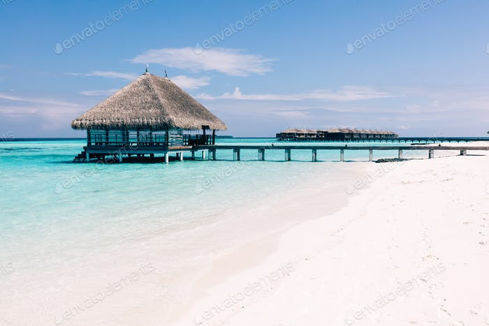 Wooden terrace on stakes and jetty on tropical island