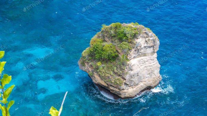 Lonely Rock in Sea Watter, North Coast, Nusa Penida, Bali, Indonesia
