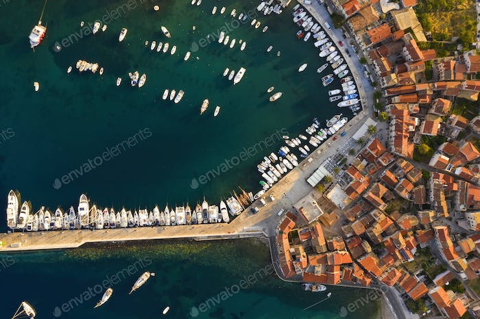Top view of docks in Croatia with yachts and boats in summer at sunrise