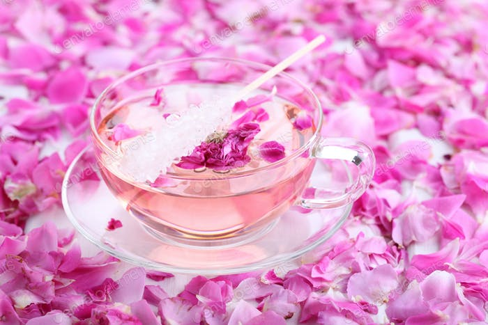 Tea with rose petals in a glass Cup. Rose water.Concept Holiday Valentine Day.