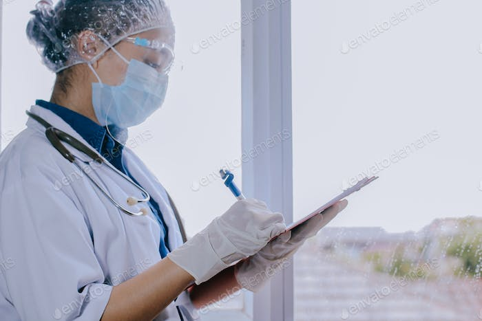 Doctor writing diagnosis report