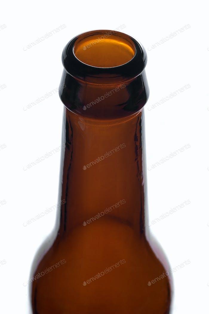 Detail of the bottleneck on an empty brown bottle