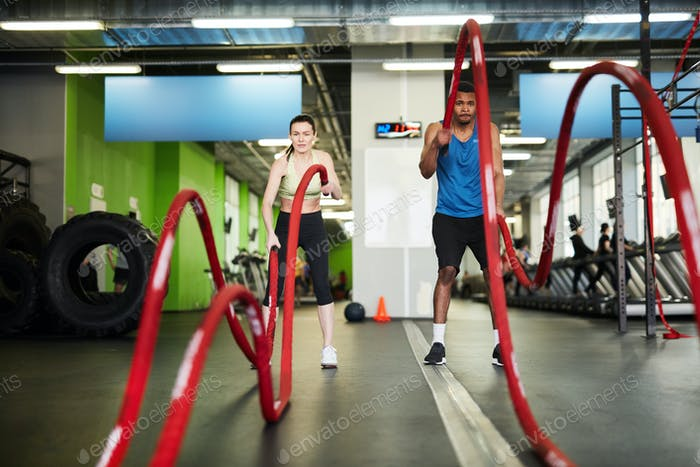 Couple Working Out with Battle Ropes
