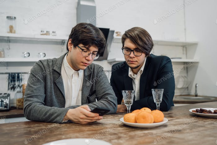 Handsome business people talking in office kitchen