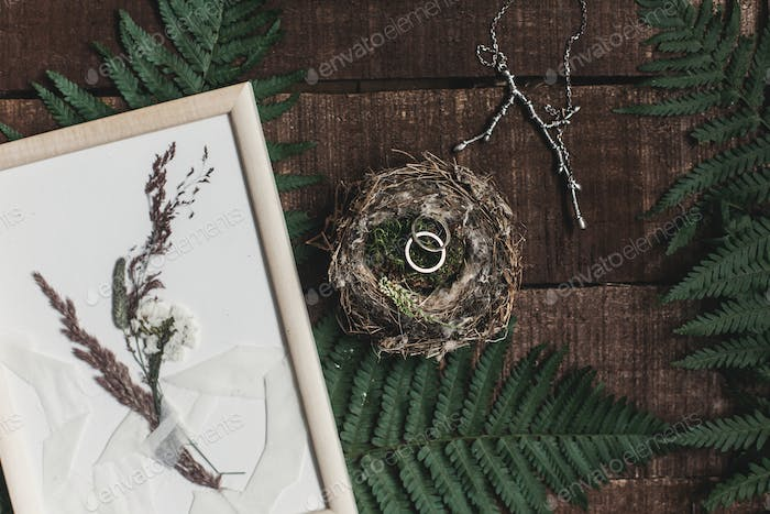 wedding rustic boutonniere and wedding rings in bird nest