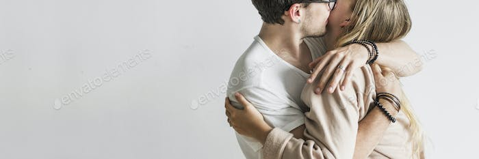 Cute couple kissing and embracing each other