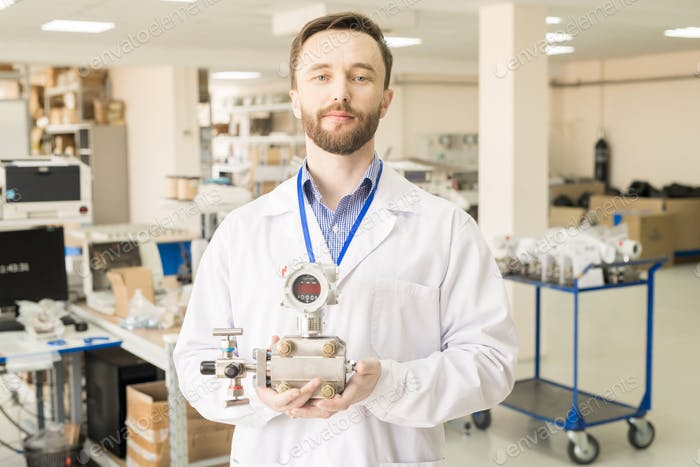 Content engineer holding manometer in quality control office