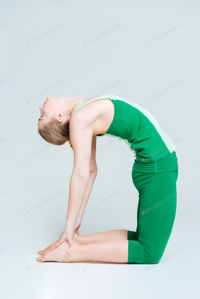 Flexible woman doing yoga exercise