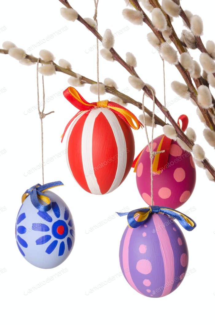 Easter eggs on willow bouquet with catkins, vertical