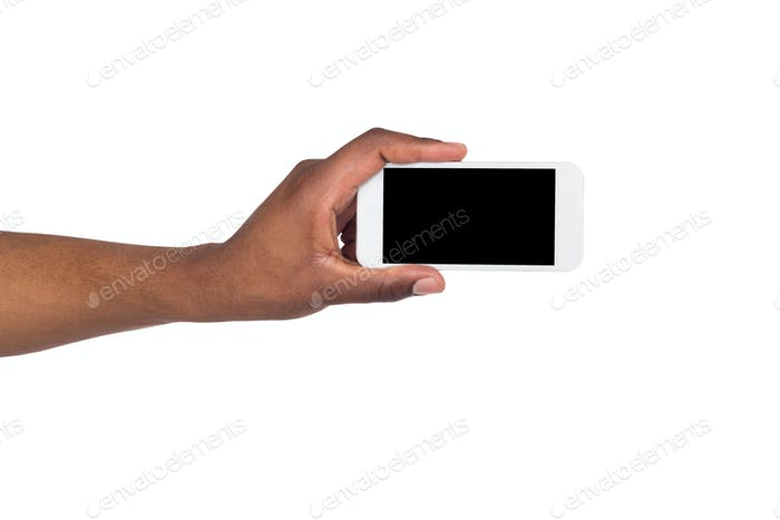 Black hand holding smartphone on isolated white background
