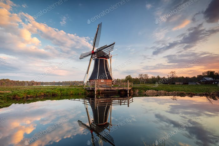 windmill and sky  reflected in water