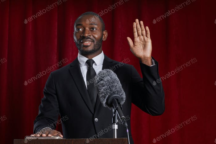 African-American Man Speaking at Podium
