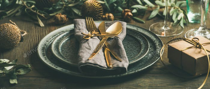 Christmas or New Years celebration table setting, wide composition