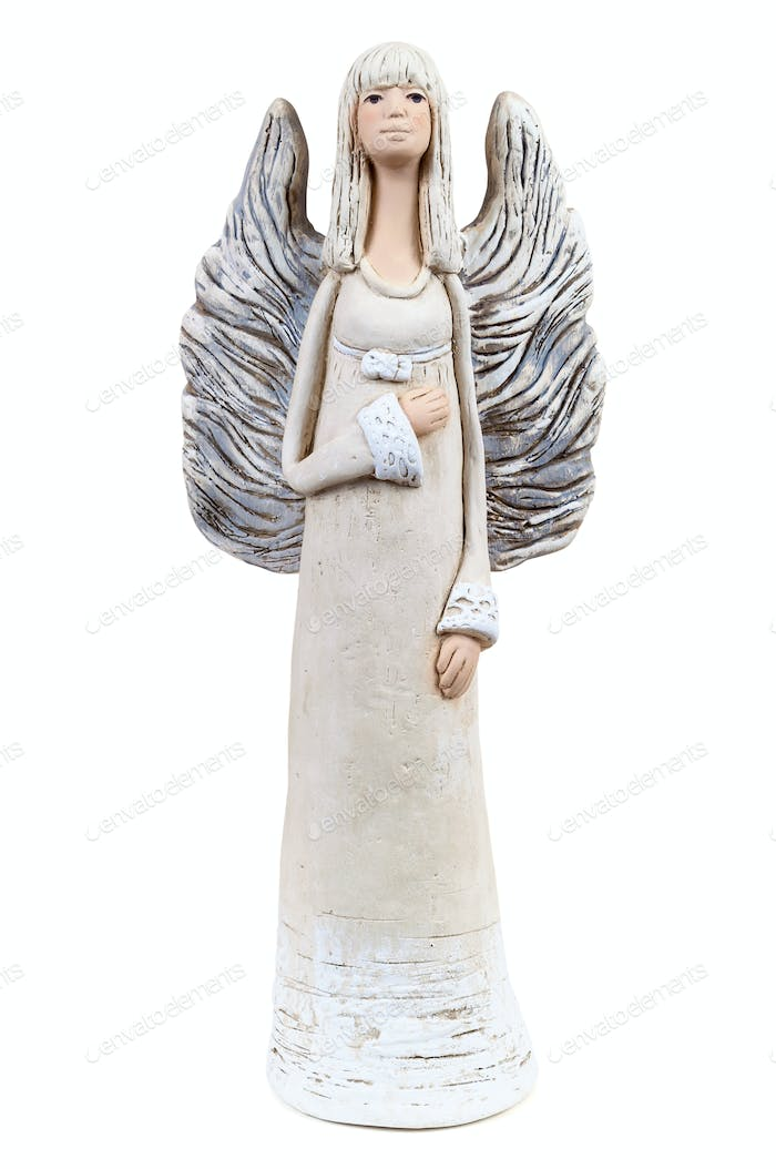 Plaster statue of an angel on white background