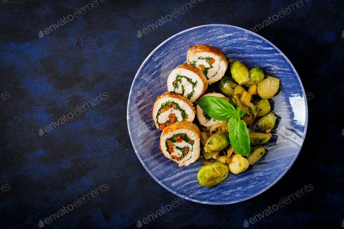 Chicken rolls with greens, garnished with stewed Brussels sprouts, apples and leeks