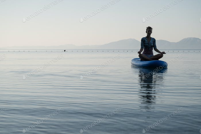 Young woman meditating in lotus position