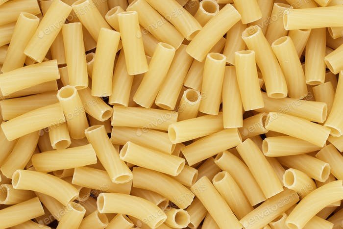 Dry Uncooked Tortiglioni Pasta Texture Background