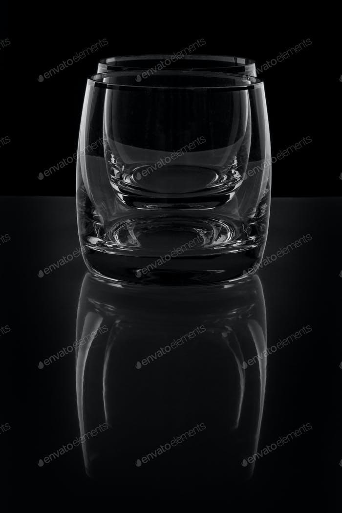Two empty glass on black