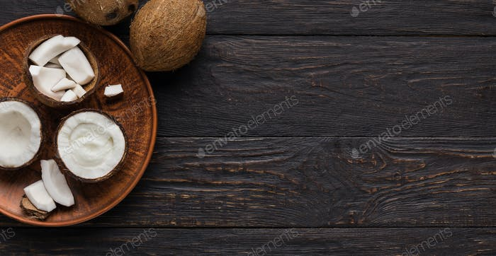 Coconuts on wooden plate
