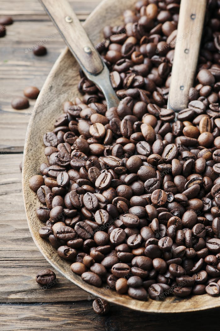 Raw coffee beans on the wooden table