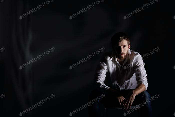 Desperate man sitting alone