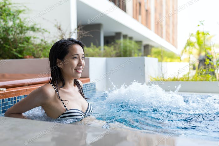 Woman enjoy in jacuzzi pool