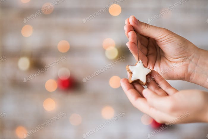 Female hands holding Christmas decorations. Copy space.
