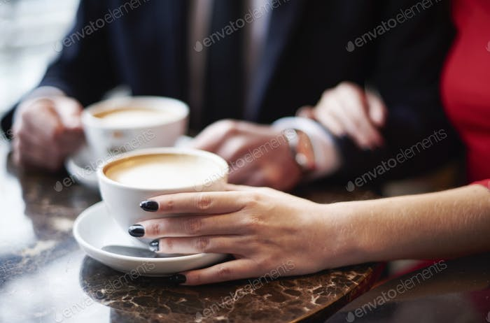 Close up of couple drinking coffee