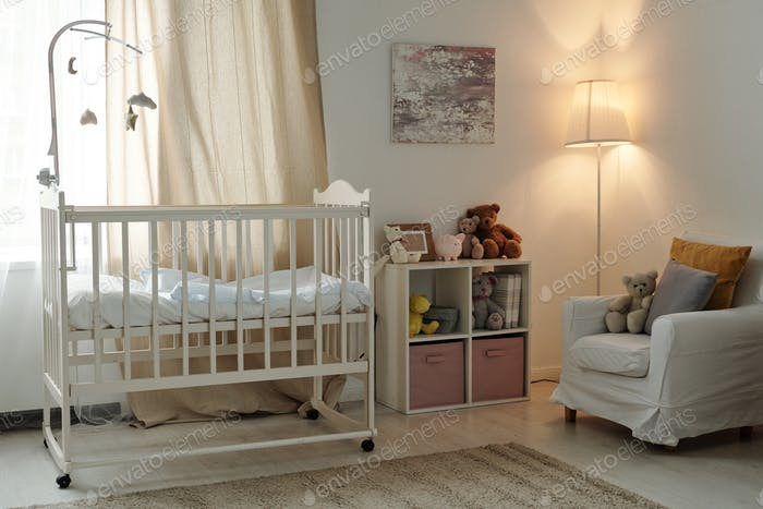 Interior of large contemporary room of baby with cradle and furniture